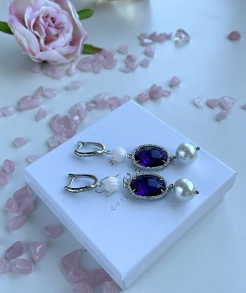 Long pearl earrings with purple crystals